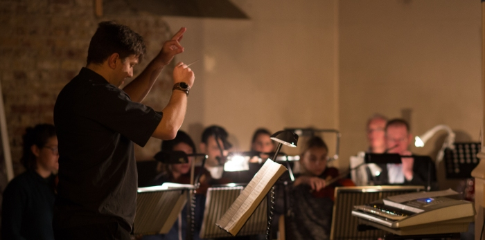 Ben Woodward conducting. Photography by Matthew Coughlan